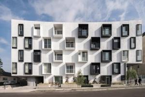 Какой дом считается многоквартирным по жилищному кодексу ?